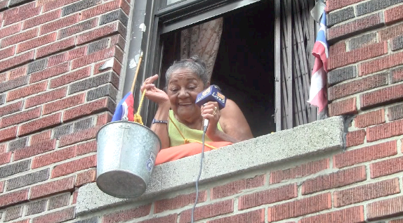 Puerto Rican Bronx Grandma Sells Icees from her second floor window