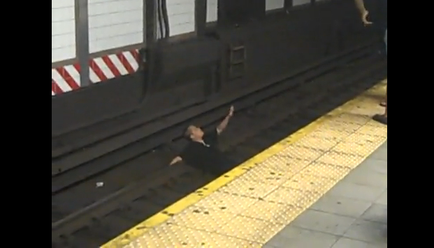 WorldView Video: Crazy Girl Sits on Subway Tracks