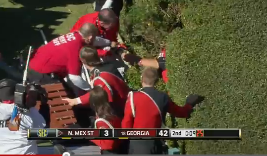 Georgia Football Player stuck in bushes