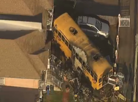 School bus crashed into house in Brooklyn, driver injured; no children