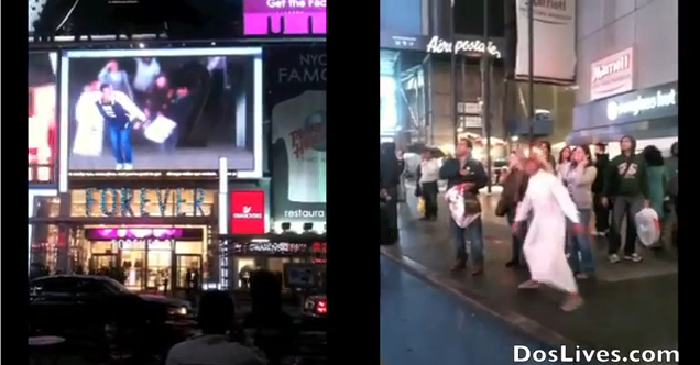 WorldView Video: Man with Flower Hat Dancing on Times Square Billboard